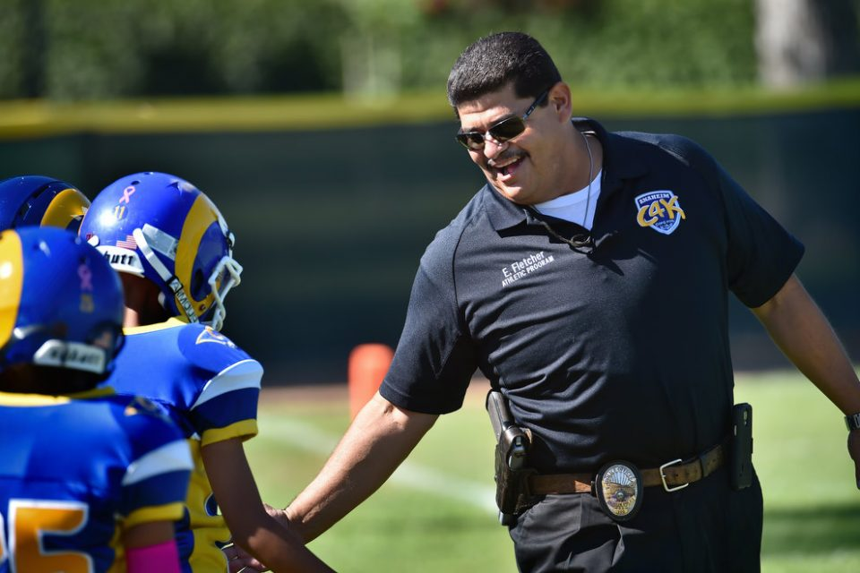 Police Handoff Football of Affection for Community