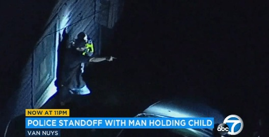 Man Holds Young Son During Standoff With Officers