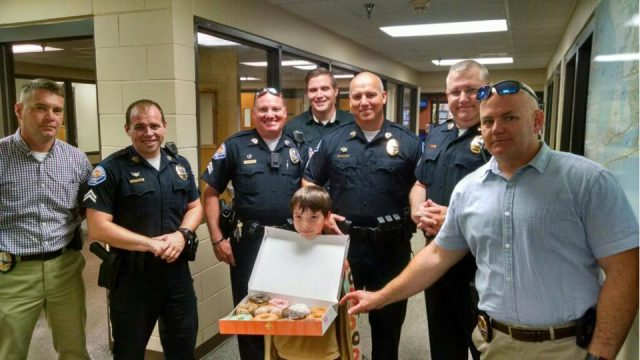 Donut Boy Spreads Good Cheer to Cops One Donut at a Time