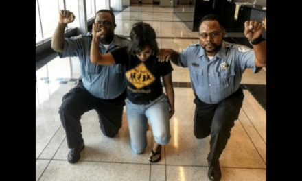 Cops in Uniform Kneel With Activist in Chicago