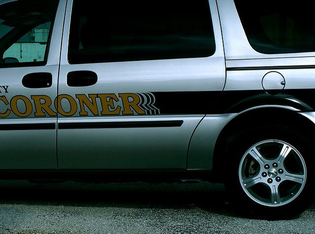 (Coroner vehicle taken from Flickr under creative commons attribution 2.0, photo by Jo Naylor. License useage can be found at https://creativecommons.org/licenses/by/2.0/)