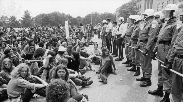 (Police 1970s Vietnam protest source info Original photo from Flickr, taken by Katie Simmons-Barth Photography. Original photo was cropped, height was shortened to fit our dimensions. https://creativecommons.org/licenses/by/2.0/)