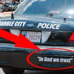 "Do the words ""In God We Trust"" belong on police cars?"