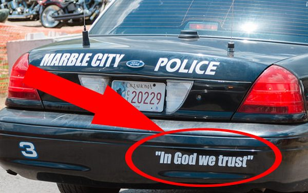"""Do the words """"In God We Trust"""" belong on police cars?"""