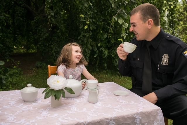"Submission by Angela Siminiak: ""My husband Justin and our daughter Avery. A local photographer, ShutterLove did a Tea Party setup as 'Tea Party with my Hero' for all first responders and various other professions."""