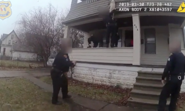 Caught on Cam: Dog Dangling From Balcony Saved By Police Officer