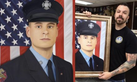 Officer Presents Handmade Portrait of Fallen Marine To Family At His Wake