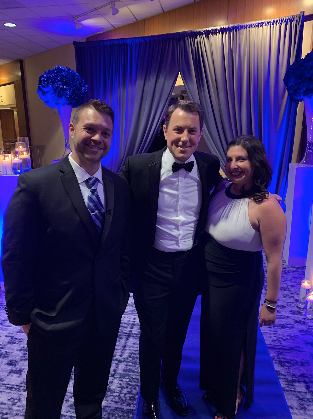 Todd Piro from Fox and Friends and producer Sam pose for a picture at the Blue Honor Gala with LET National Spokesman Kyle Reyes