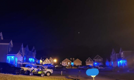 Community turns neighborhood blue in honor of fallen officer