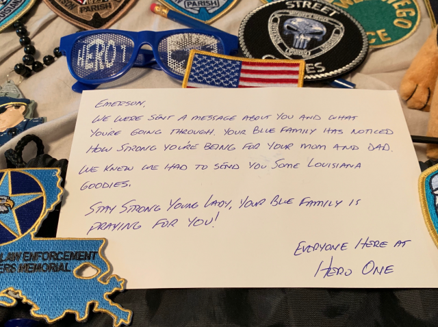 Officer's child receives incredible display of love from police family before surgery