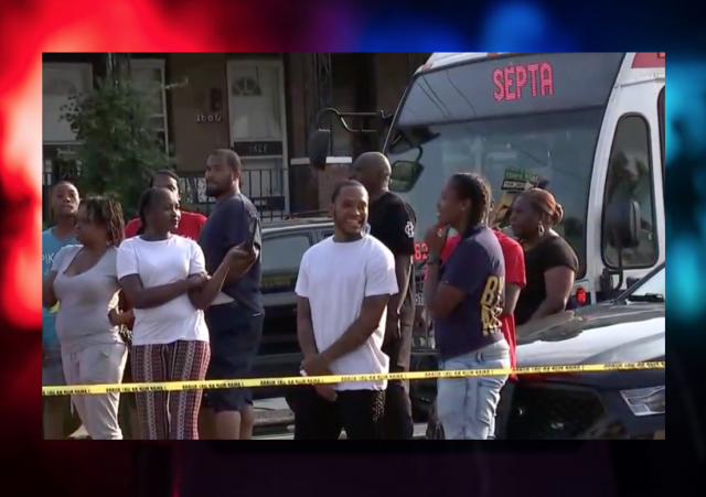 Bystanders laugh and cheer as six officers are gunned down