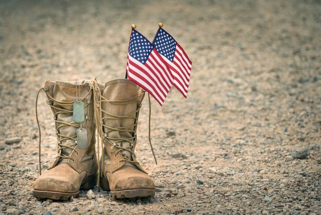 military_combat_boots_flag_dogtags_adobe_stock