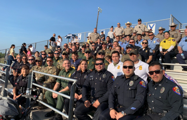 A sea of blue: Cops gather to fulfill promise to their fallen brother.