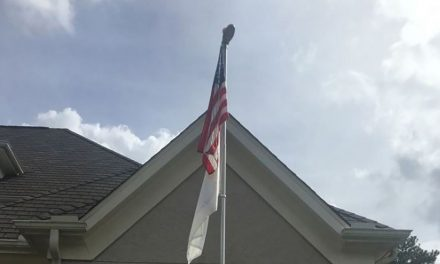 Homeowner's association demands mother of mass shooting victim remove flag honoring son