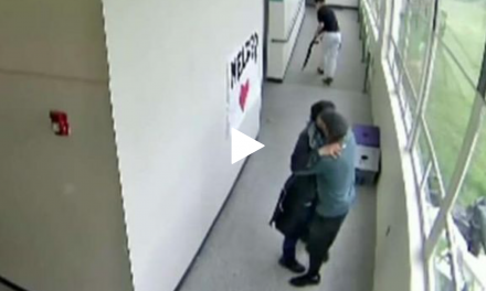 WATCH: Coach hugs it out with would-be school shooter, takes away loaded shotgun