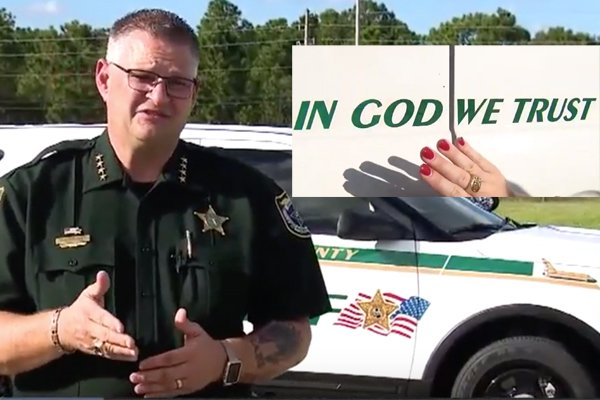 "Woman demands ""In God We Trust"" comes off police vehicles.  Chief responds: ""Go fly a kite."""