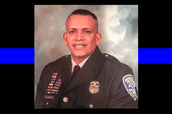 Veteran officer dies after car crash. Sources: He was driving to hospital after gunshot wound.