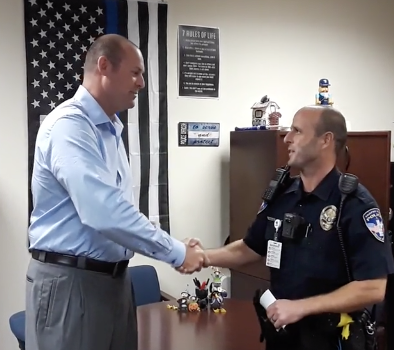 CEO quietly sells company, focuses on being a police officer.  Refuses to collect a salary.
