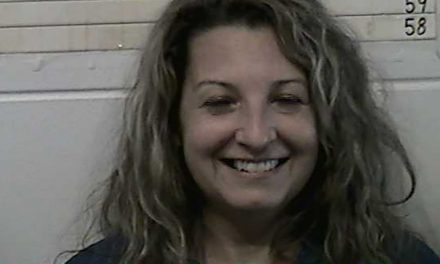 Woman smiles in mug shot when arrested for murdering husband