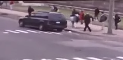 In this image, you can see the officer run towards the vehicle