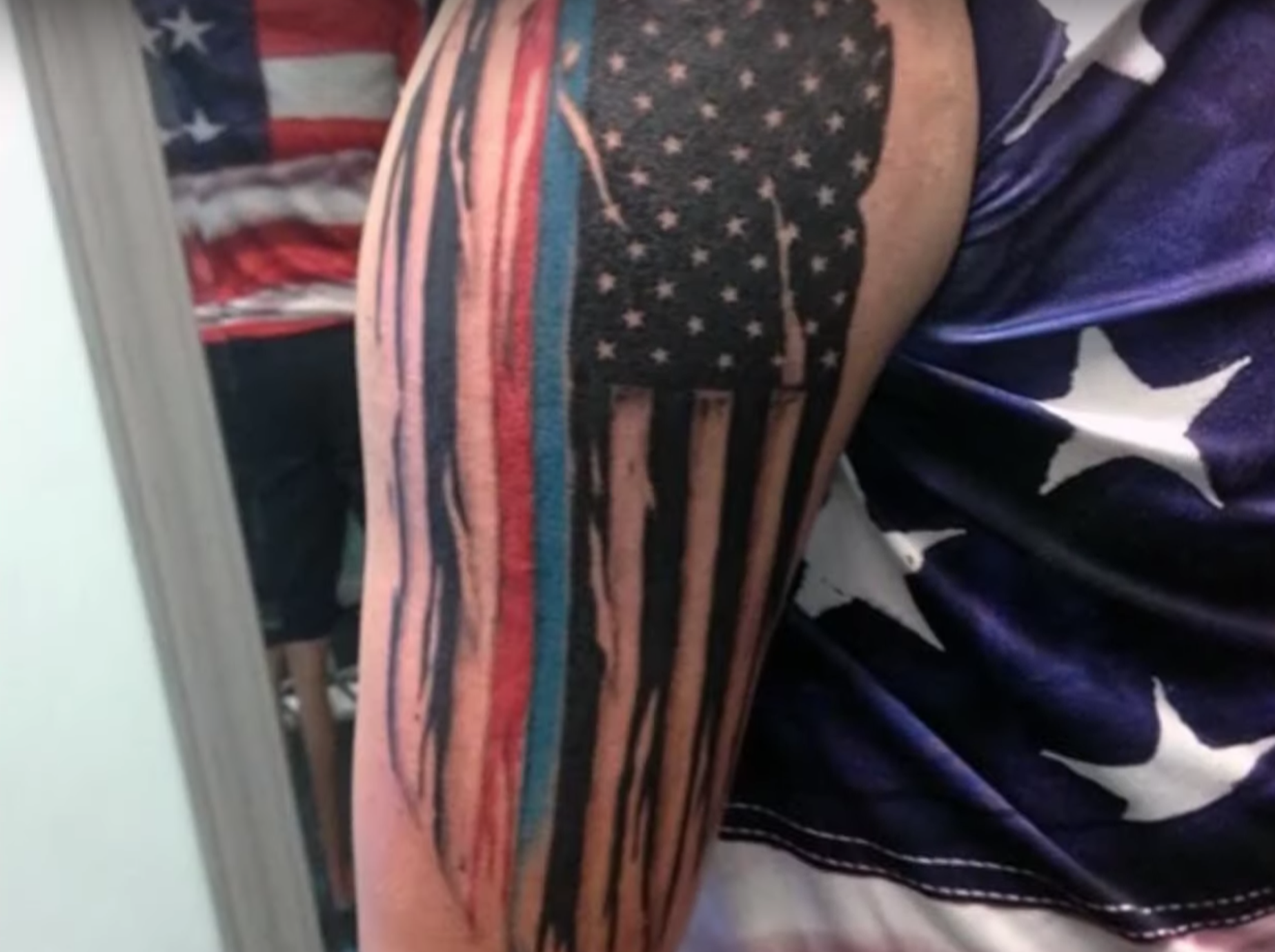 Controversial thin blue line flag tattoo