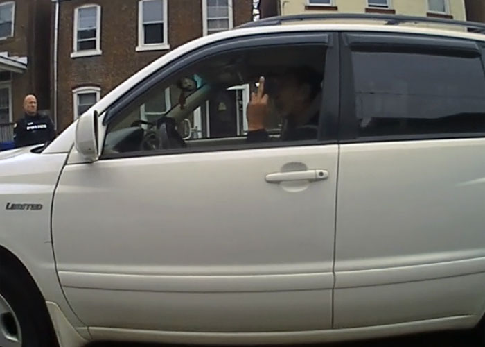Newburgh City Councilman Omari Shakur gives police officers the finger during a traffic stop. (Image from body cam video obtained by Mid-Hudson News)