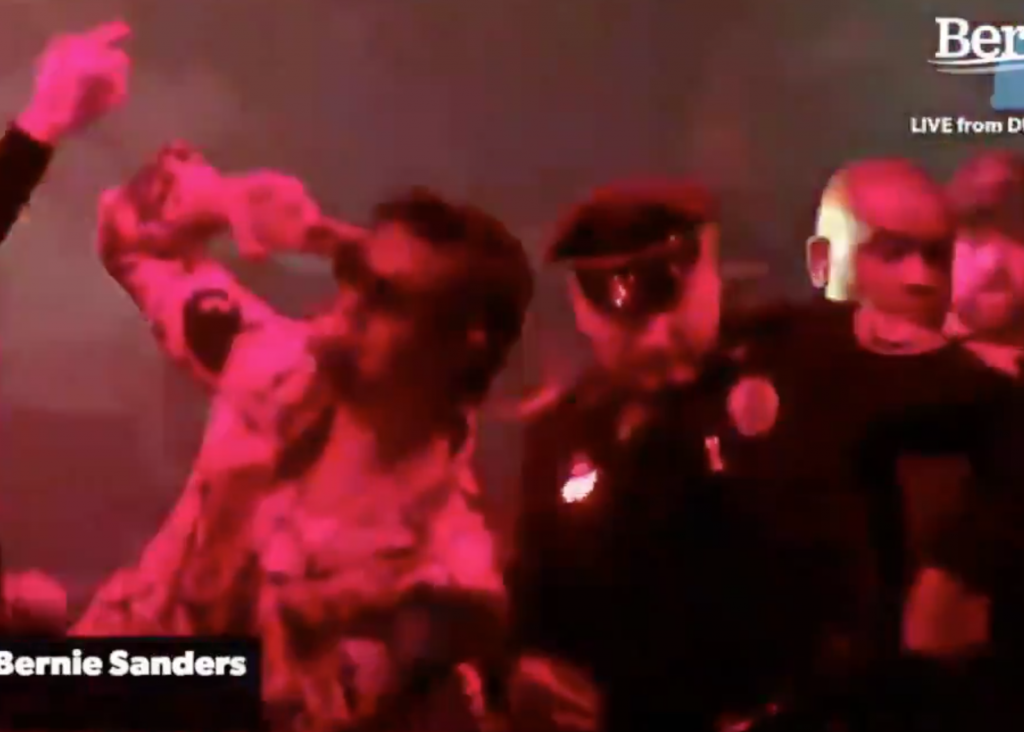 Police respond when crowd storms stage during concert at Sanders rally - band starts playing anti-police song