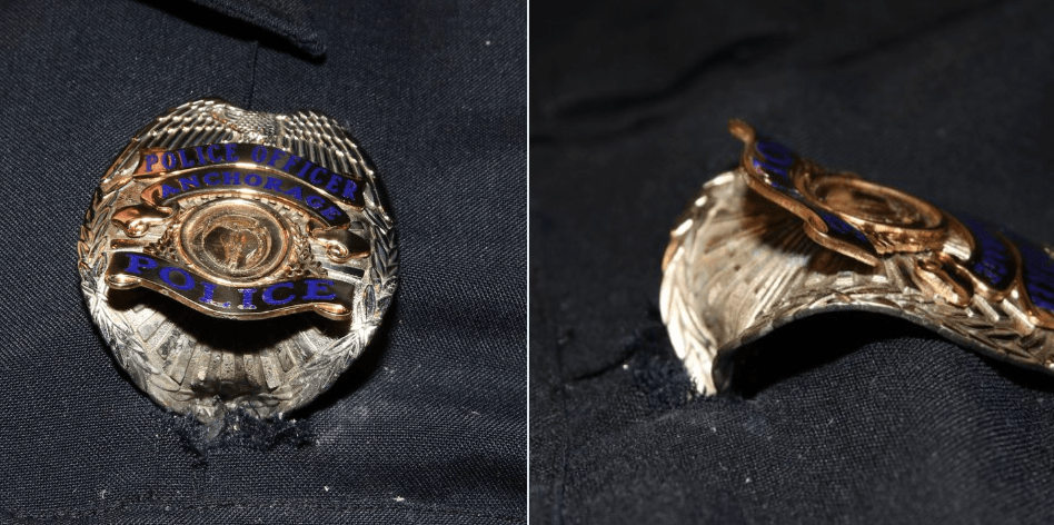 Miracle: Suspect opens fire on officer. Bullet hits officer's badge, saving his life.