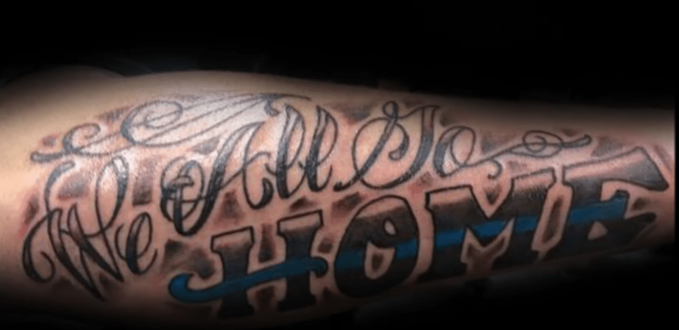 Thin Blue Line tattoo - screenshot from YouTube video: 50 Thin Blue Line Tattoos For Men