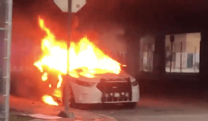 Officer down: Deputy stabbed in neck by violent rioters. Countless cruisers on fire.