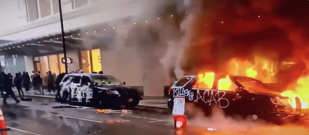 Watch: Suspected Antifa militant steals rifle from burning police SUV. Seattle violence exploding.