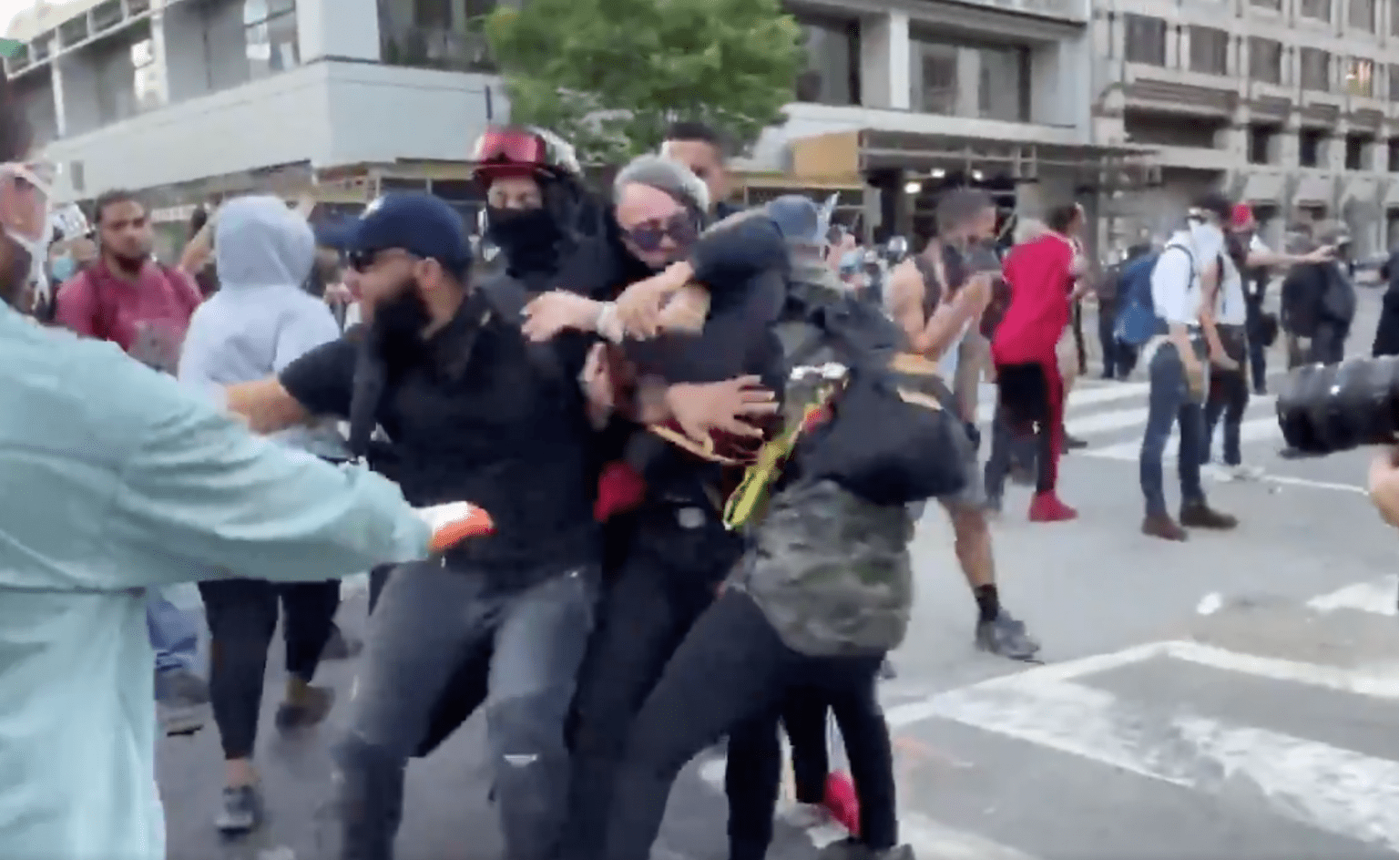 Watch: Rioter causing damage in DC tackled by protesters and handed to police: 'Take his ass!""