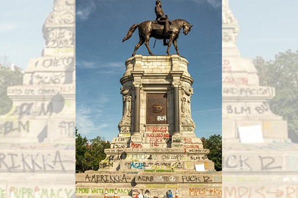 Armed officer arrested for trespassing on rooftop of unoccupied building overlooking Robert E. Lee monument