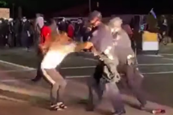 Parents flip out on police after their daughter, 14, arrested for throwing rocks at officers during protest