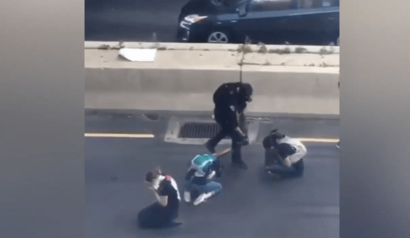 Philadelphia officer charged after pepper spraying three protesters to clear a freeway