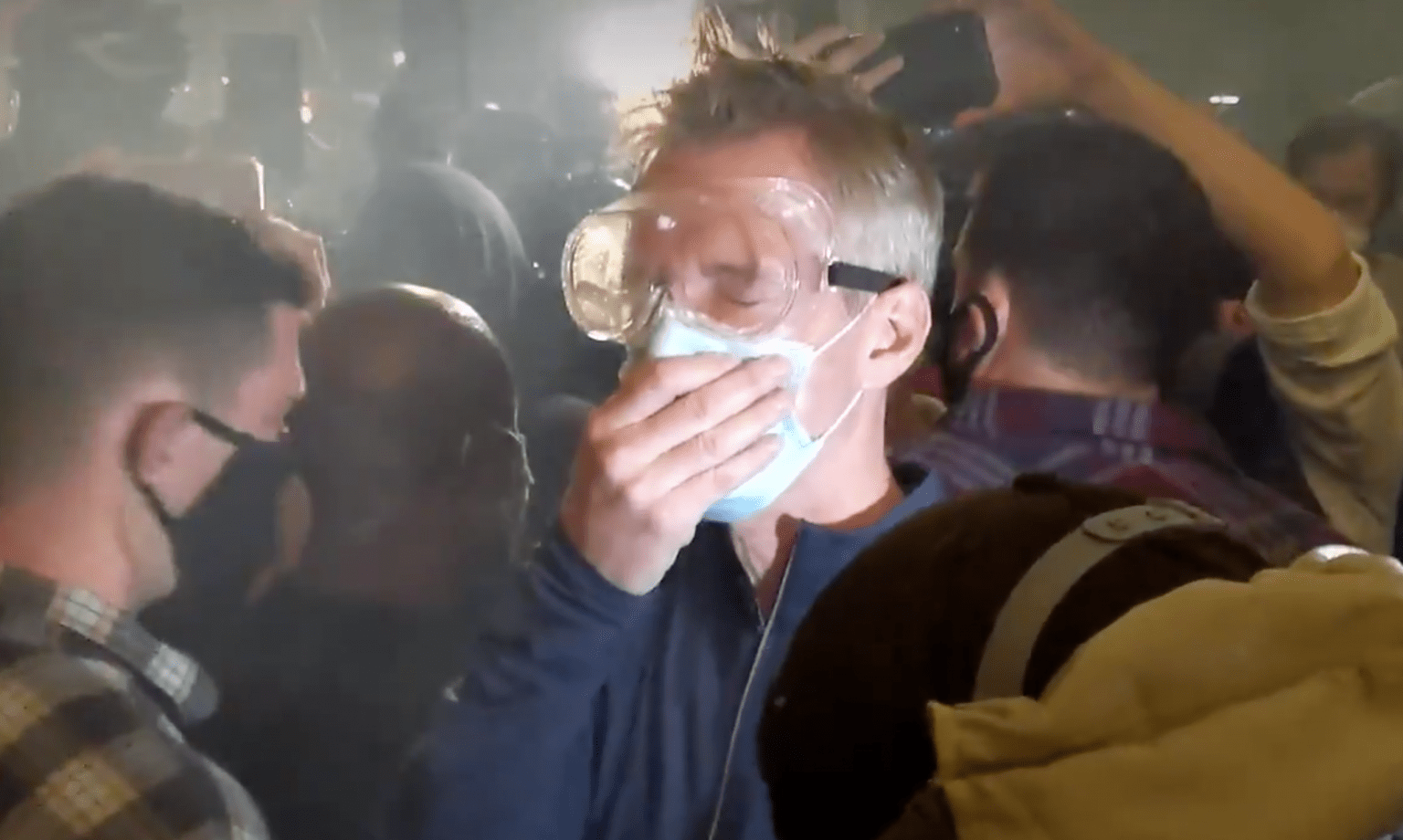 Portland mayor joins protestors - gets jeered, cursed at, objects thrown at him - and gets exposed to tear gas