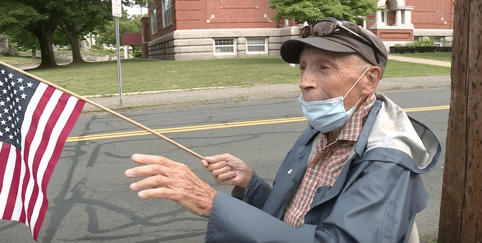 WWII veteran, 95, dying of cancer waves American flag outside home daily: 'This is what I fought for'