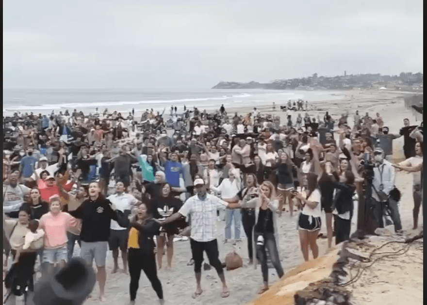 Thousands of Christians show up for beach services, worship indoors in defiance of California ban