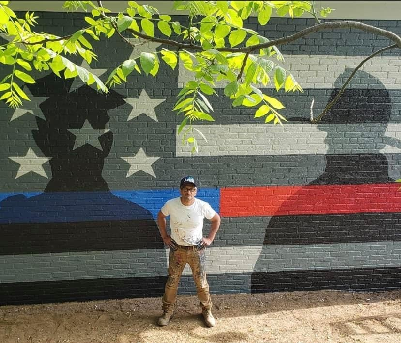 NYC tells American artist Scott LoBaido: 'Remove thin blue line outside police department or risk legal actions'