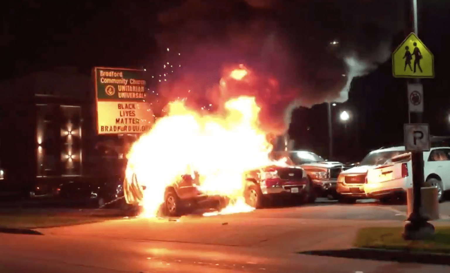 Car dealership torched, officer hit in the head with a brick, widespread looting and police attacked in night of mayhem