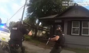 Protestors demanded an officer be fired for shooting this 'unarmed woman' who tried to kill him with a knife.