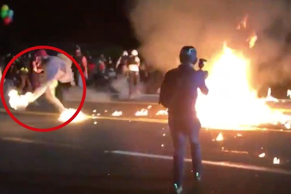 Portland rioters throw molotov cocktail at police, lighting protestor on fire. Police then save his life.