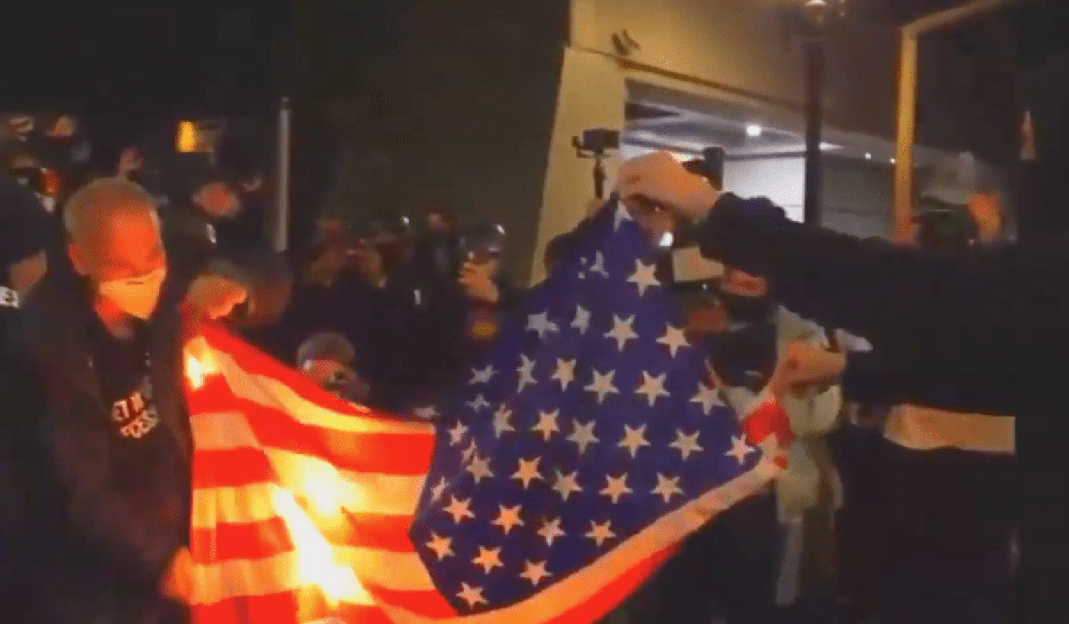 Portland: Far left rioters torch American flag, attack police with rocks, bricks and fireworks