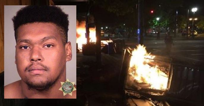 Feds hit Portland man with arson charge for pushing burning dumpster against police building
