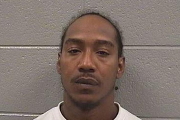 Chicago man charged with shooting five people. He was out on bail for possessing a firearm as a felon.