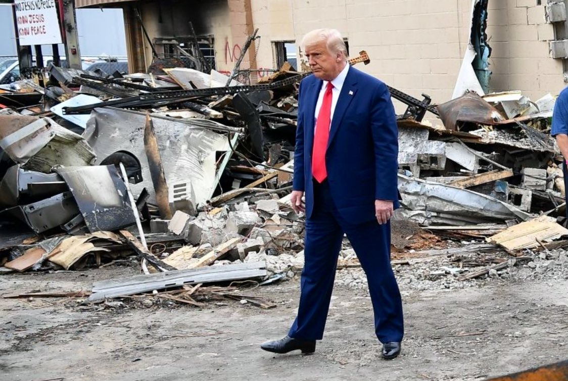 President Trump walks through piles of debris in aftermath of destruction caused by BLM/Antifa rioting in Kenosha. Uploaded to Twitter.