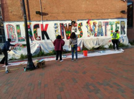 Massachusetts city uses taxpayer money to fund sickening anti-police BLM mural dripping blood and skulls