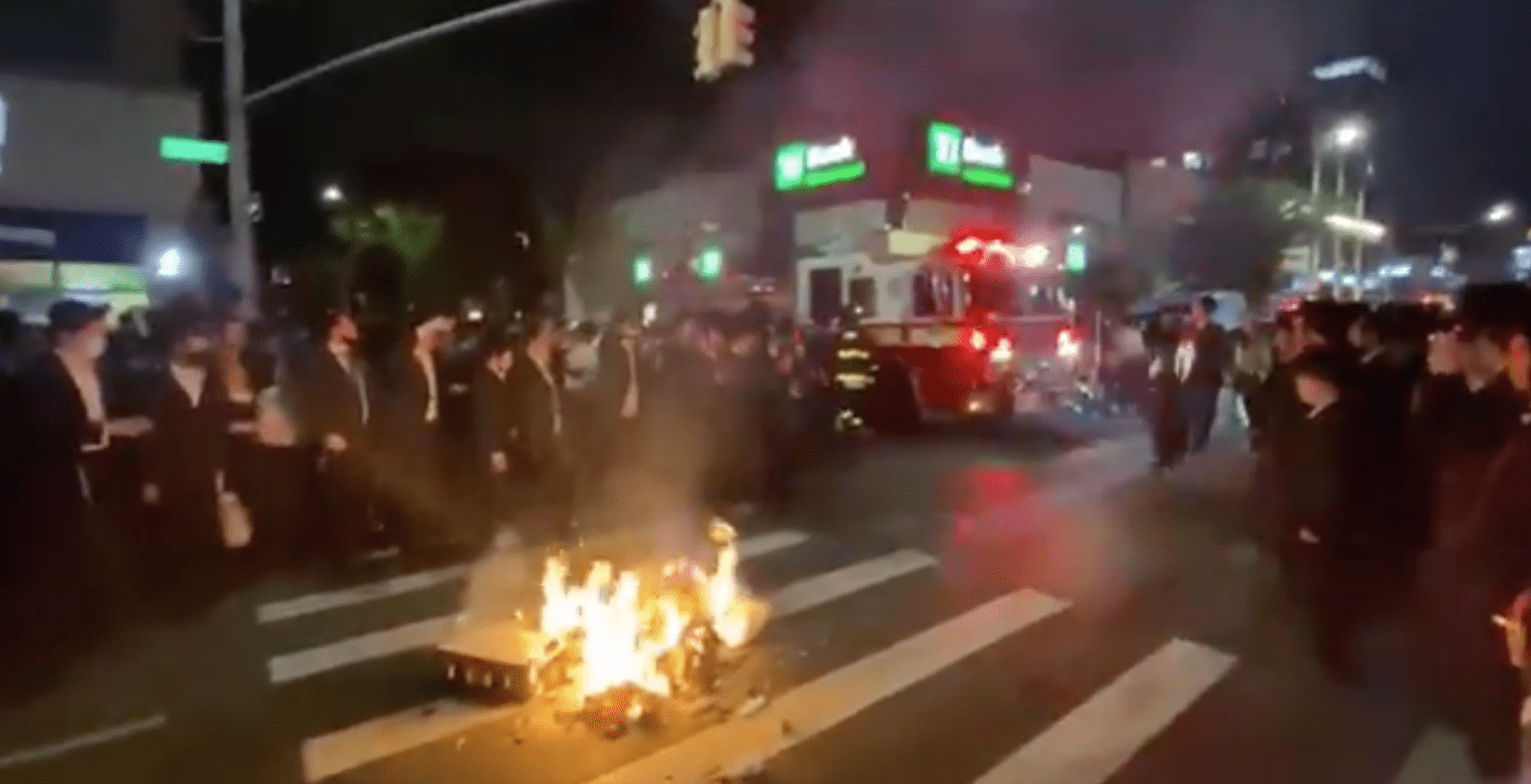 Orthodox Jews hold fiery, but mostly peaceful mask burning protest