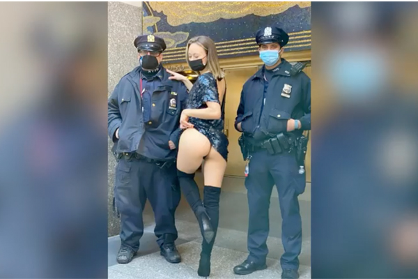 Watch your six: Instagram butt model Anastasia Fields poses with NYPD cops