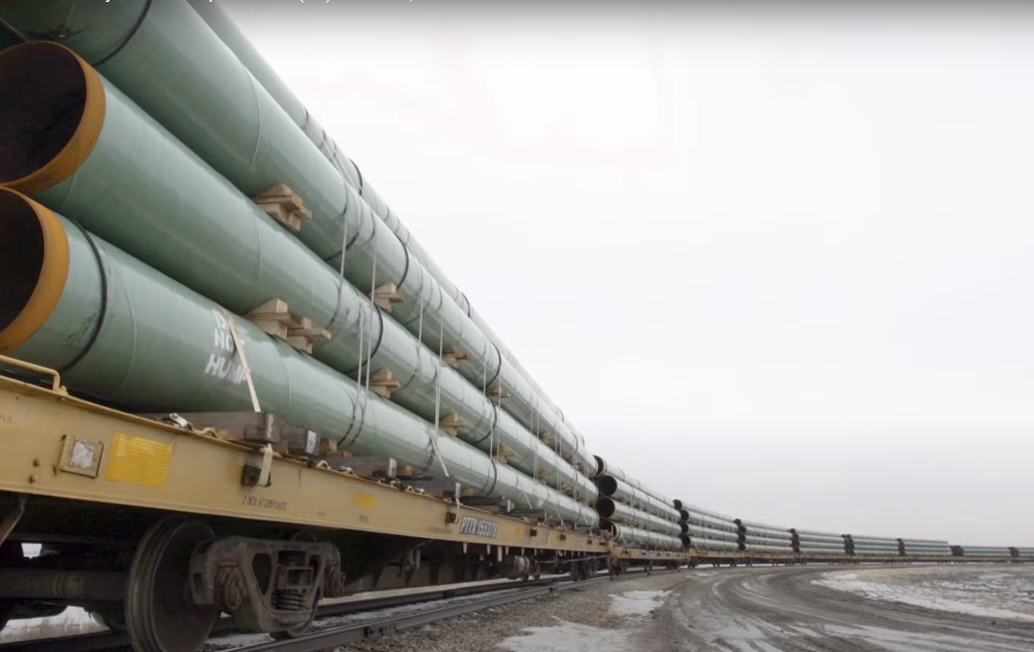 Pipe being transported by train to the Keystone XL pipeline - Screenshot courtesy of The New York Times on YouTube